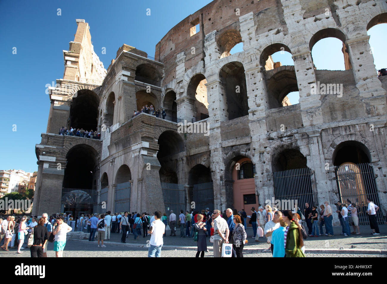 the mid morning queue of tourists queuing around the side of the Colosseum to gain entry Rome Lazio Italy - Stock Image
