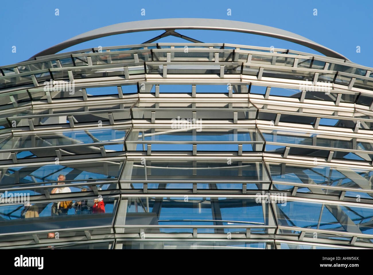 Horizontal close up of tourists looking at the view from inside the glass dome on the roof of the Reichstag on a Stock Photo