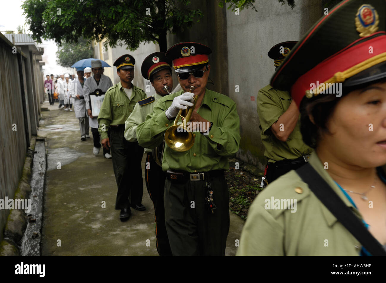 Members of a brass band dressed in police uniforms during a funeral ceremony in Ningbo Zhejiang China June 2006 - Stock Image