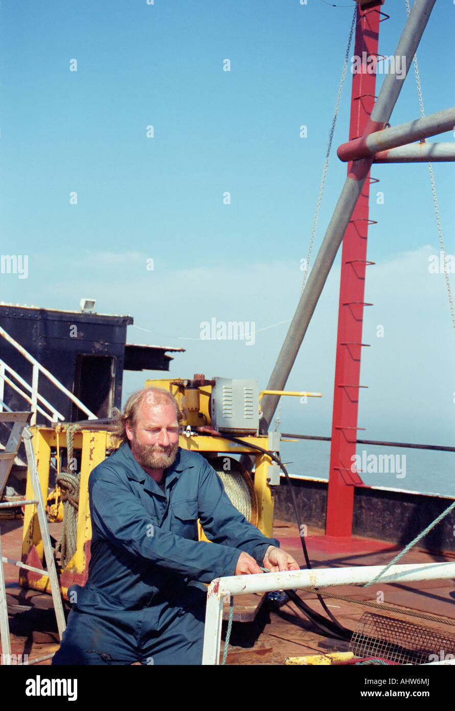 A security guard at the Principality of Sealand operates the winch that pulls visitors on to the tower. - Stock Image