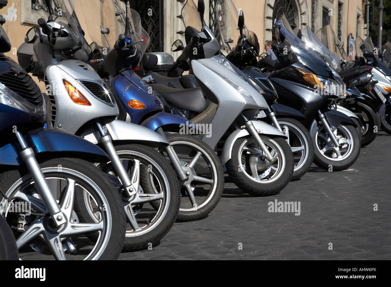 Row of front of scooters parked on a street in Rome Lazio Italy - Stock Image
