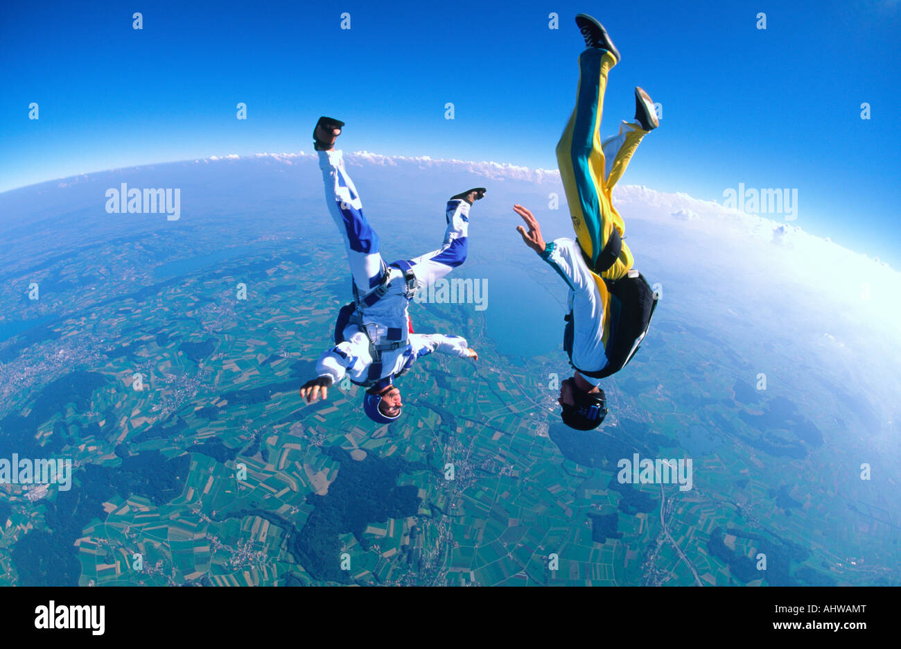 Two Skydivers enjoying falling towards eaurth together in a headdown position - Stock Image