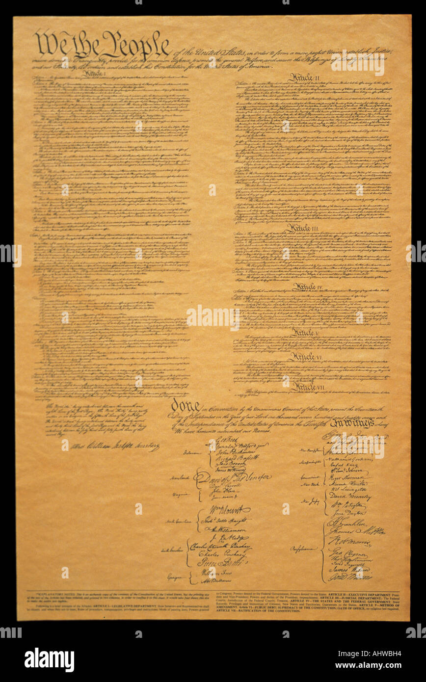 This shows the entire original U S Constitution on its faded parchment paper The document begins with he phrase We The People - Stock Image