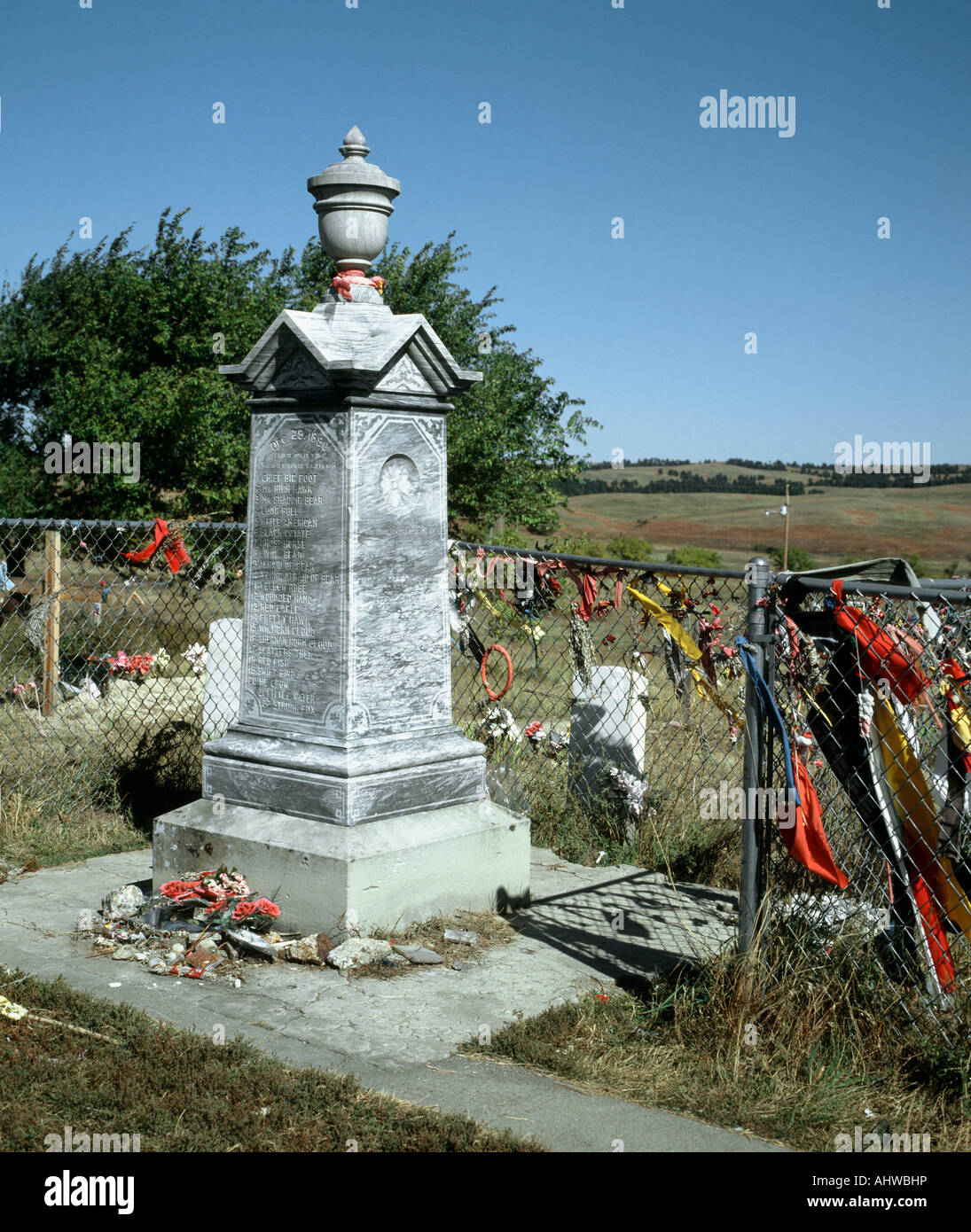 Battle of Wounded Knee monument with surrounding prayer flags in cemetery Pine Ridge reservation South dakota USA Stock Photo