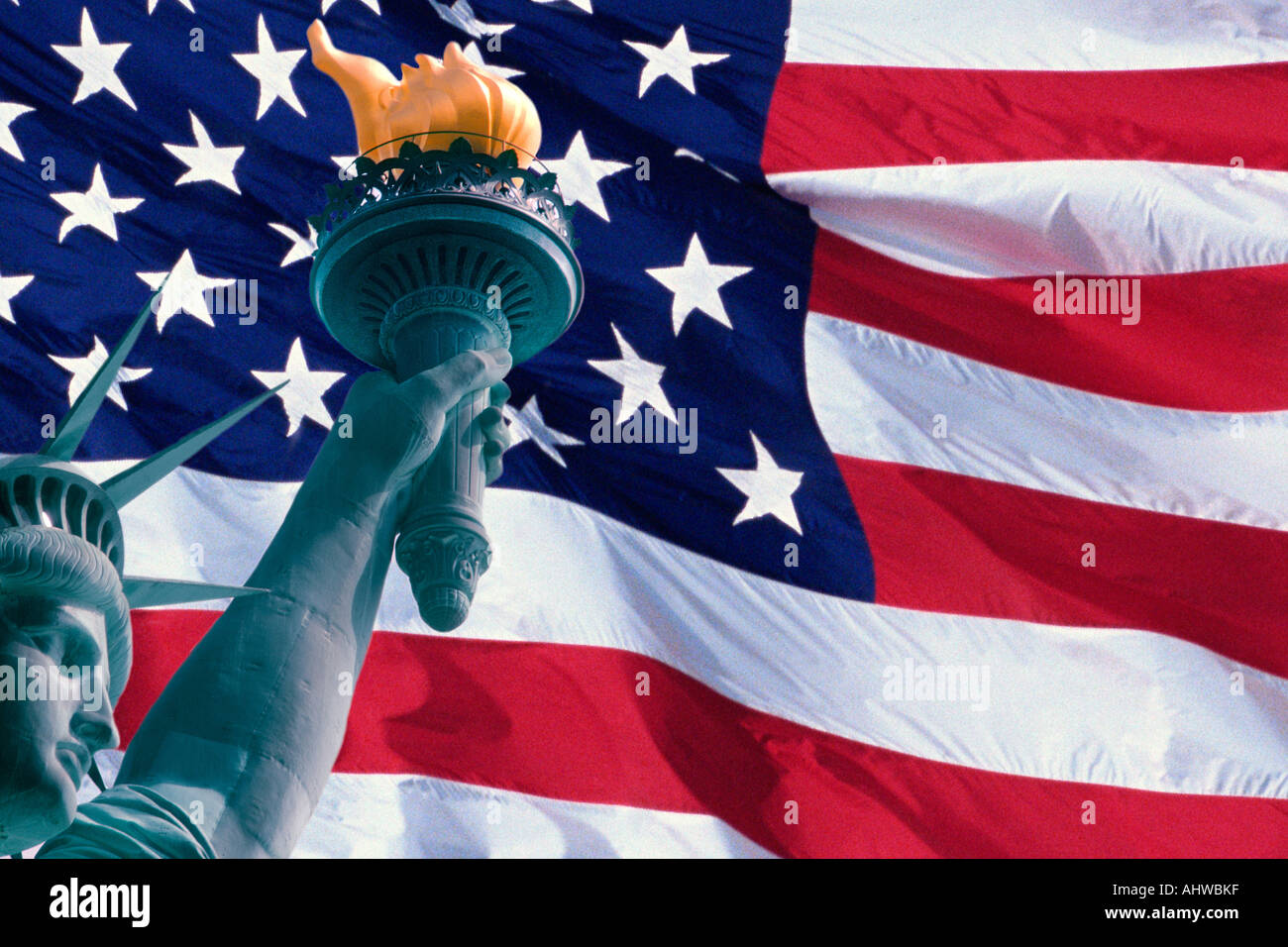 This is a digitally created image of the American flag and Statue of Liberty The head arm and torch from the Statue is - Stock Image