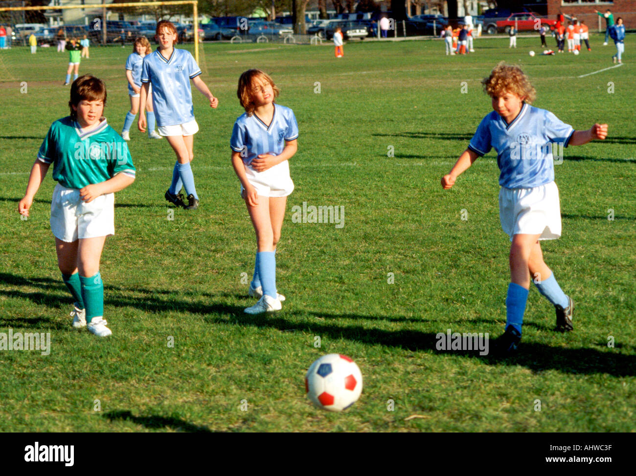 Girls 9 to 11 years old play organized soccer Stock Photo