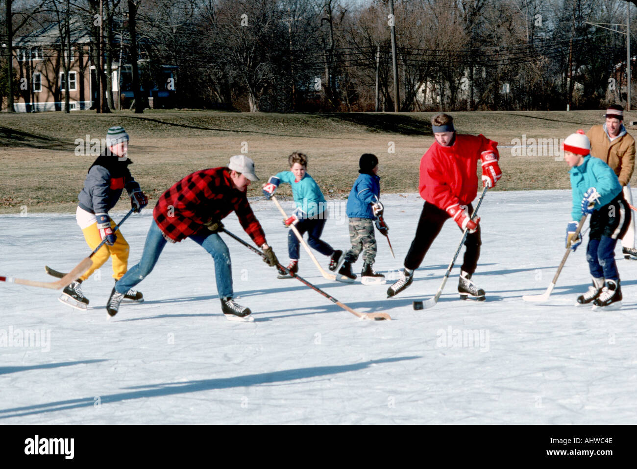 Sandlot hockey is a favorite winter sport in many northern states Michigan - Stock Image