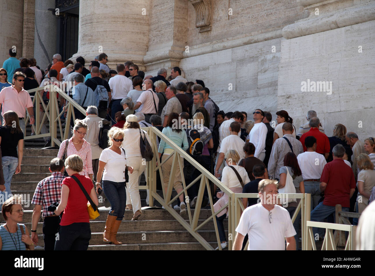 Tourists queuing outside the Basilica in St Peters Square to gain entrance to the cupola Vatican City Rome Lazio Stock Photo