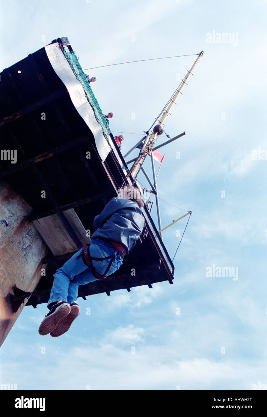 A visitor to the Principality of Sealand is pulled up on a winch. Stock Photo