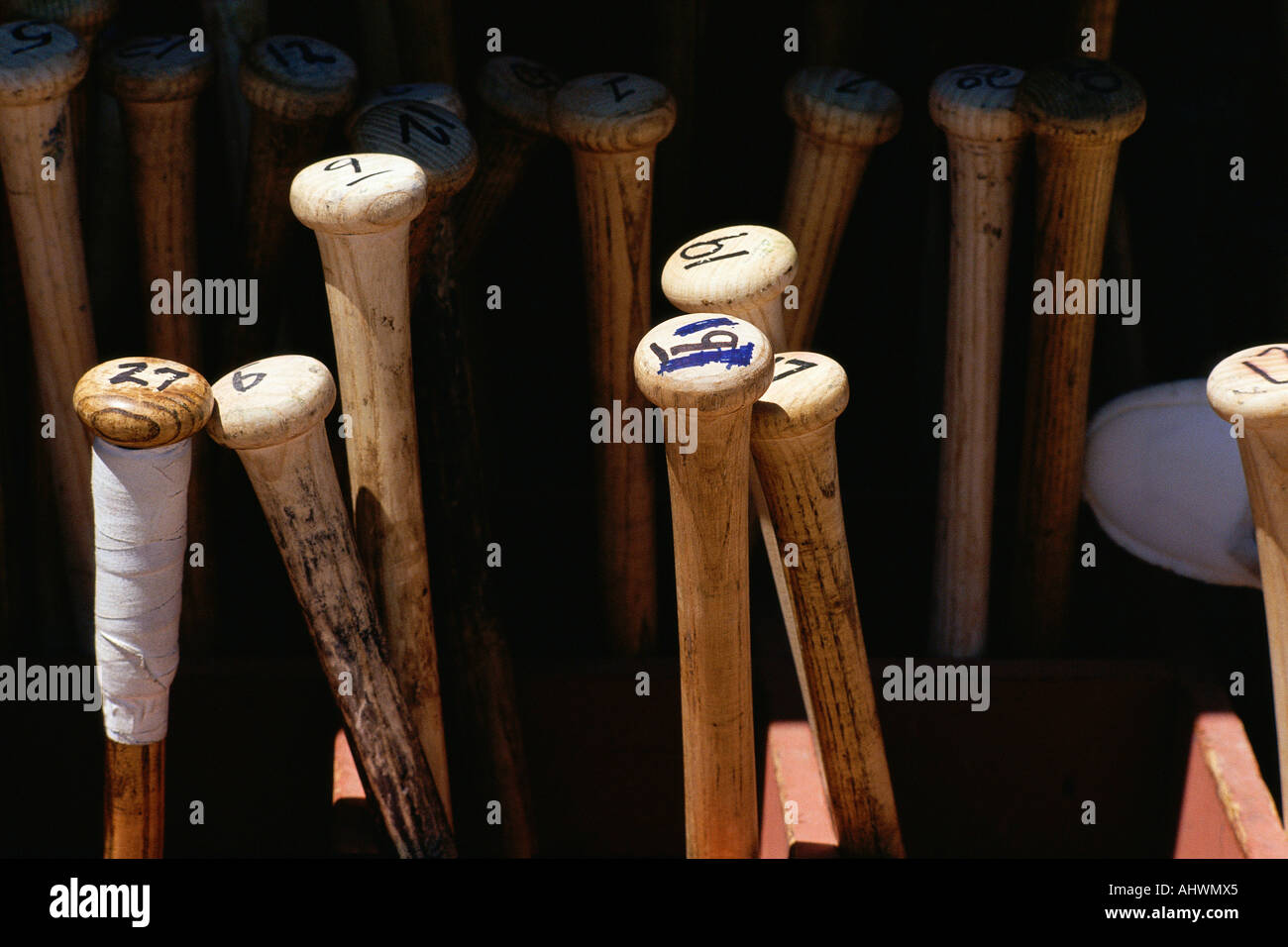 Baseball bats standing on end Stock Photo