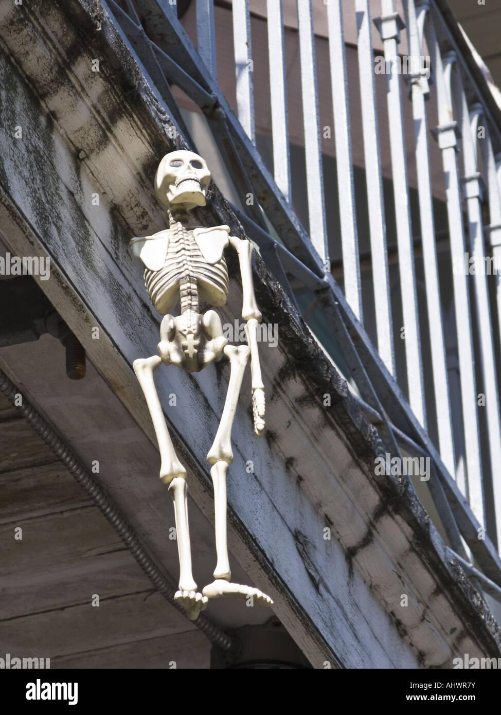 Skeleton hanging from Balcony - Stock Image