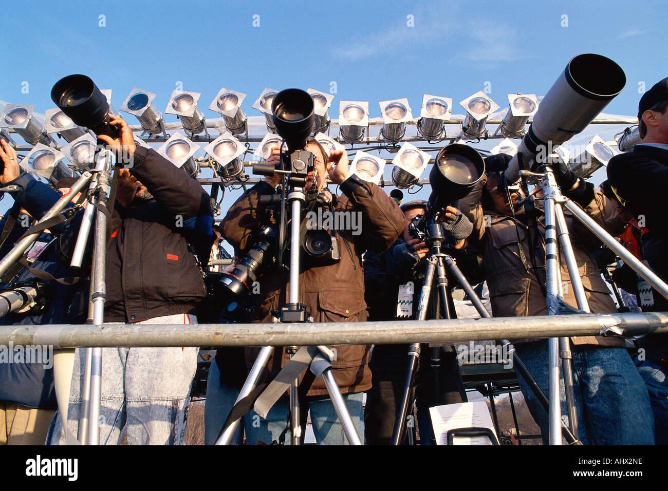 Row of photographers with telescopic lenses Stock Photo