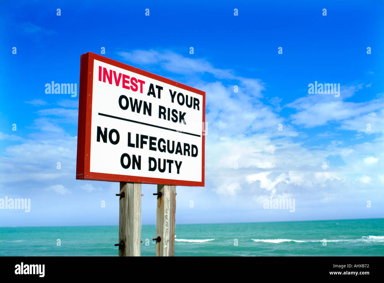 Invest at your own risk sign conveying the concept that investments are risky without a lifeguard - Stock Image