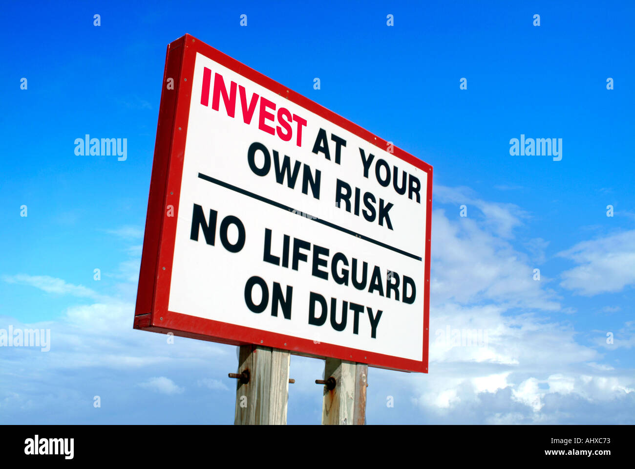Invest at your own risk sign No lifeguard on duty - Stock Image