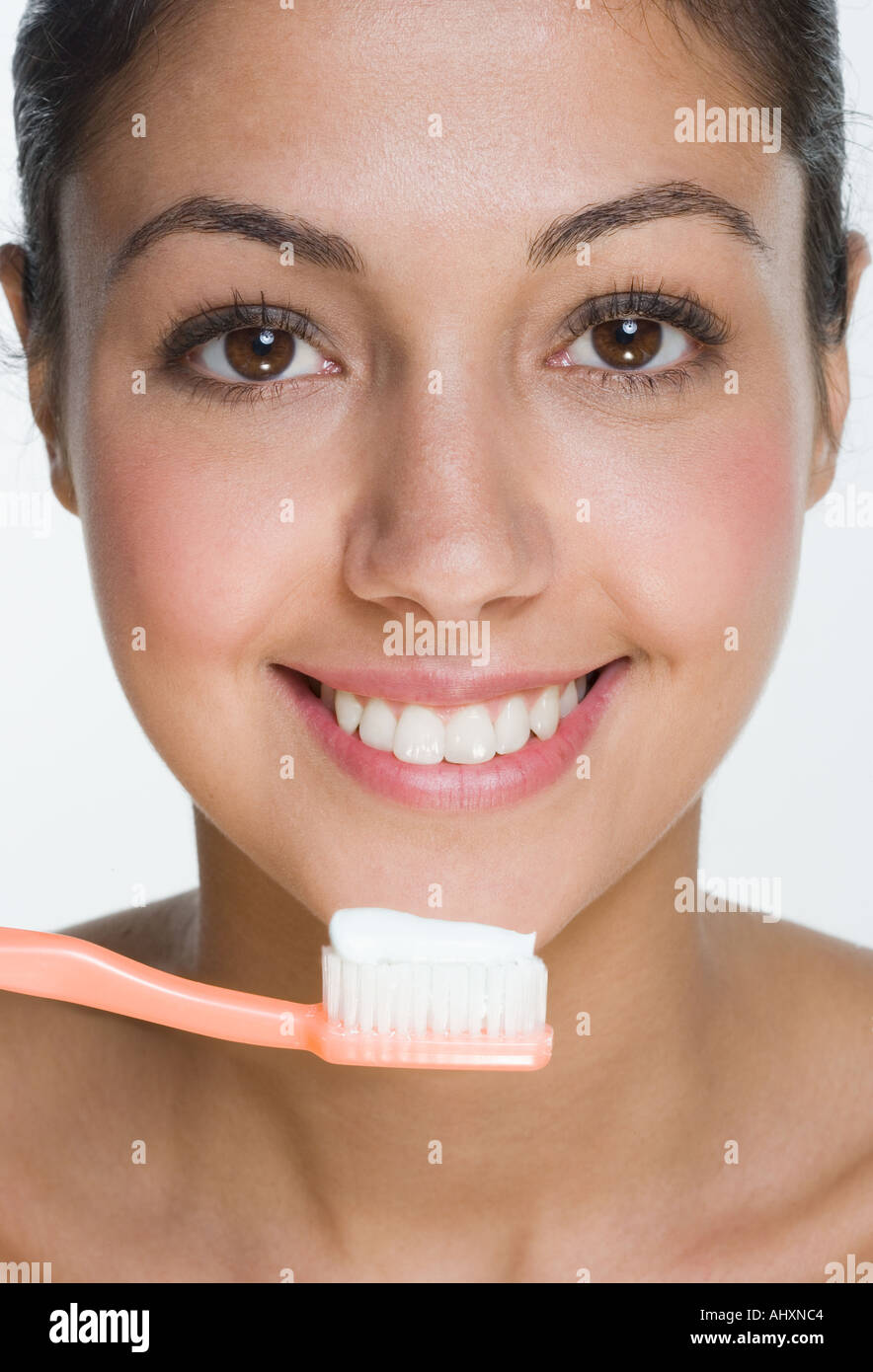 Smiling woman with toothbrush Stock Photo