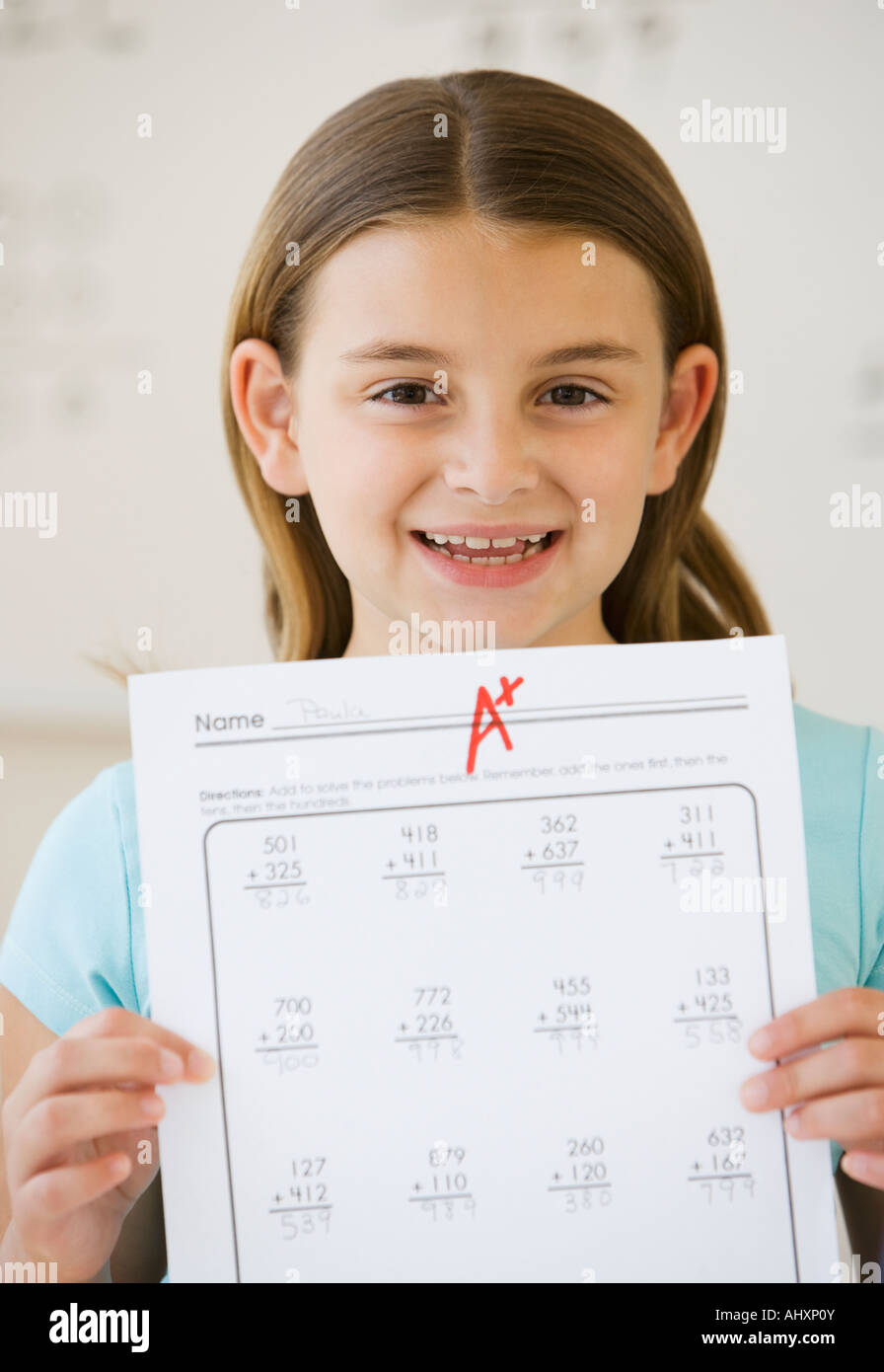 Girl schoolwork with F grade - Stock Image