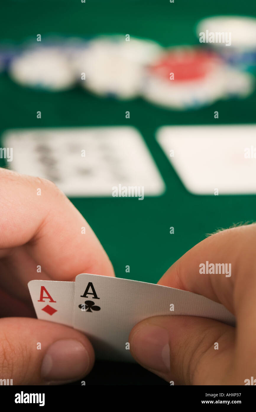 Hand holding two aces - Stock Image