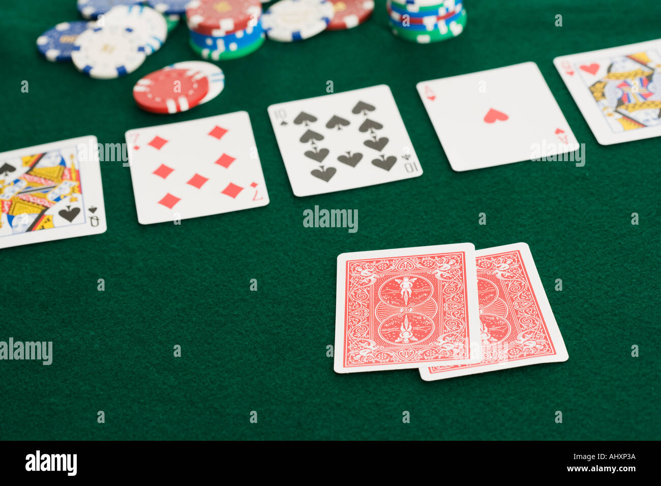 Poker hand and chips - Stock Image