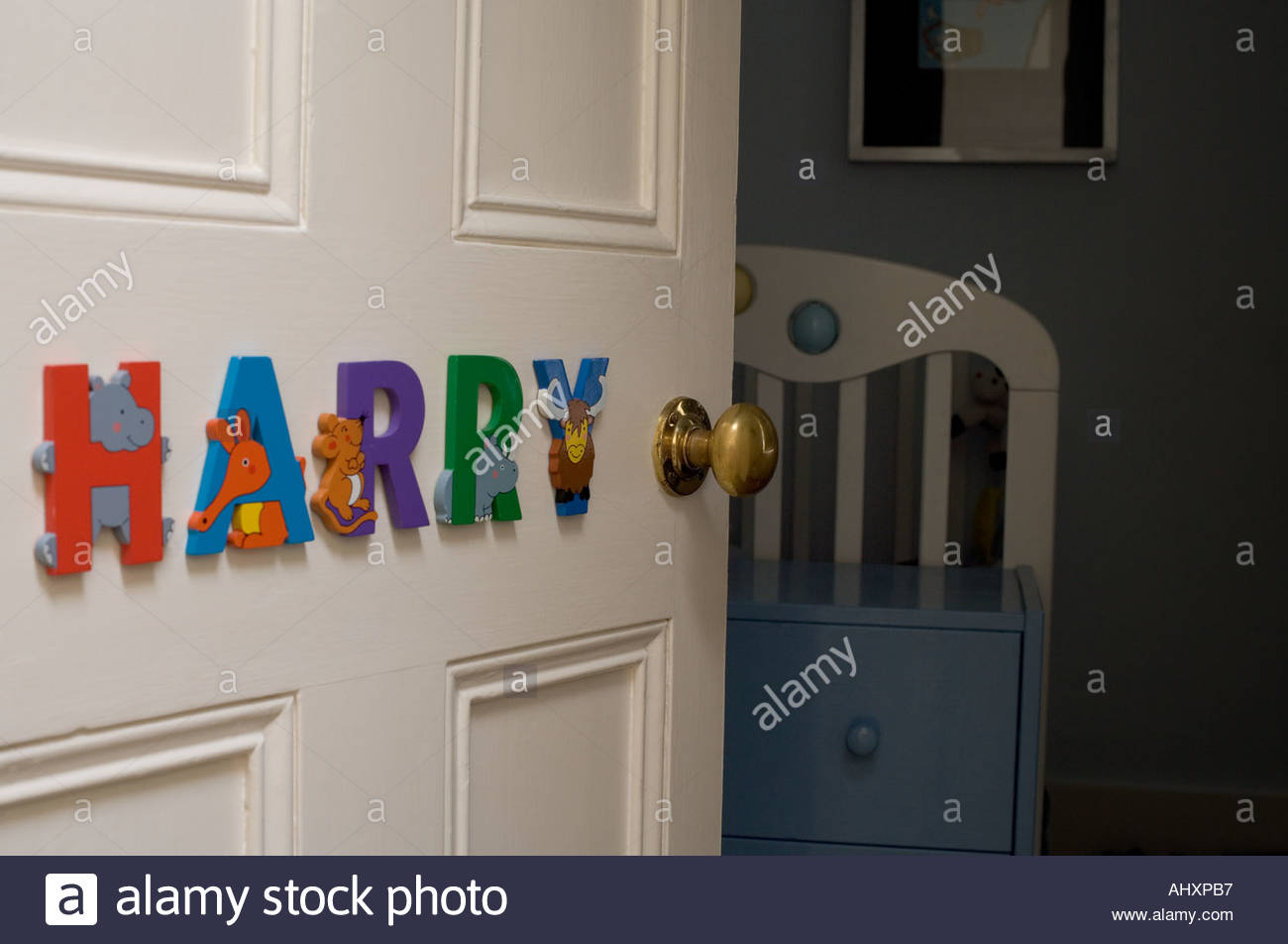 Childs bedroom with name letters on the door and child asleep inside & Childs bedroom with name letters on the door and child asleep inside ...