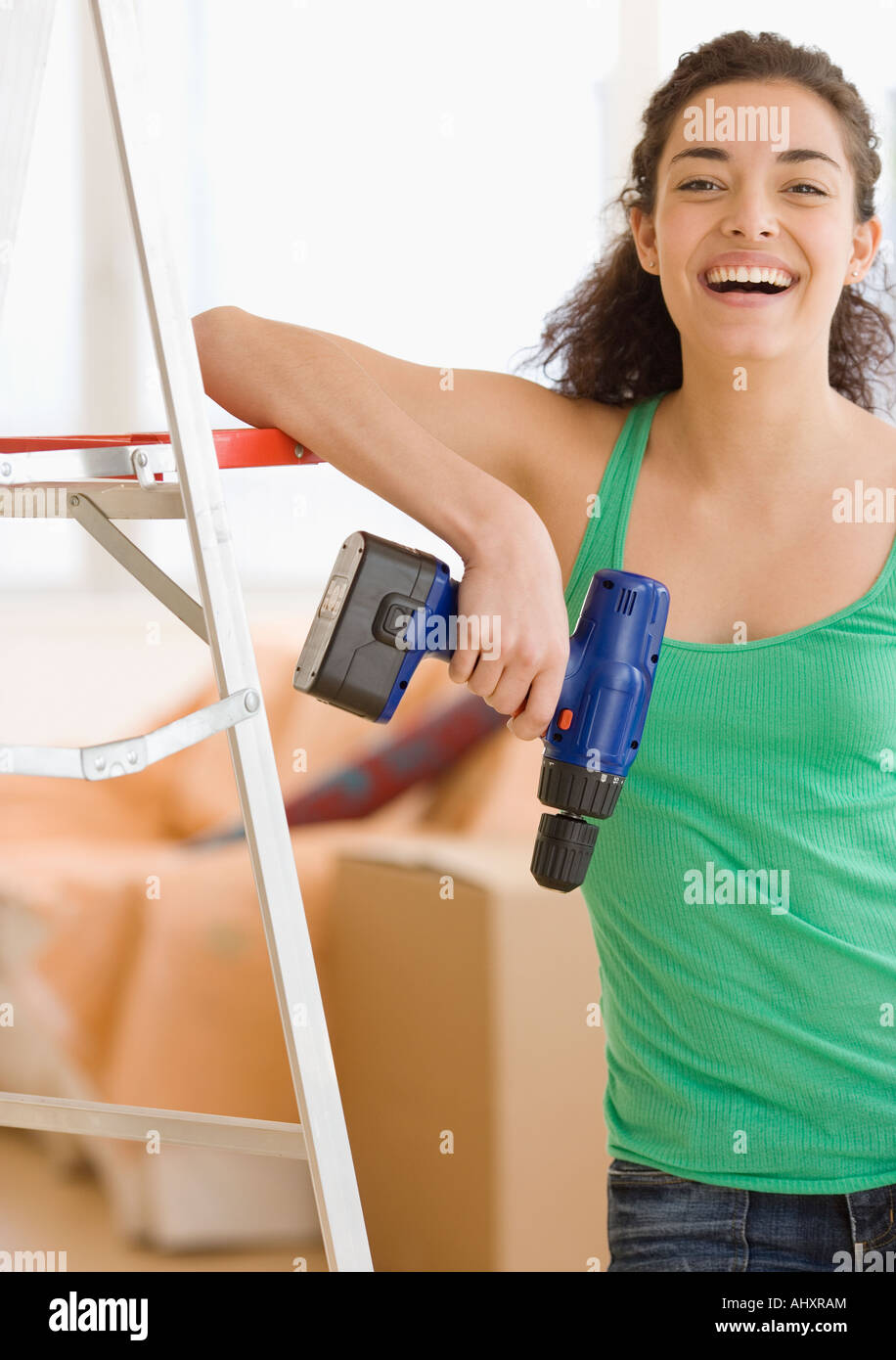 Woman holding cordless drill - Stock Image