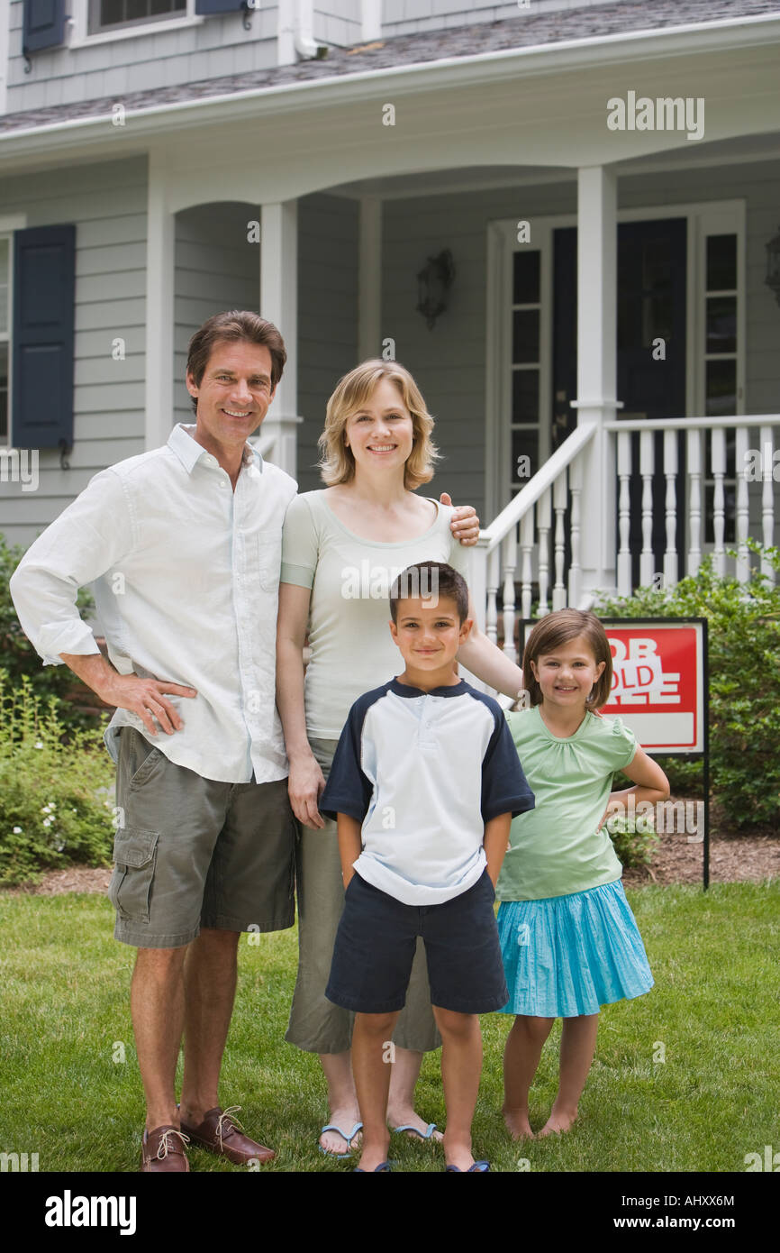 Family in front of new house - Stock Image
