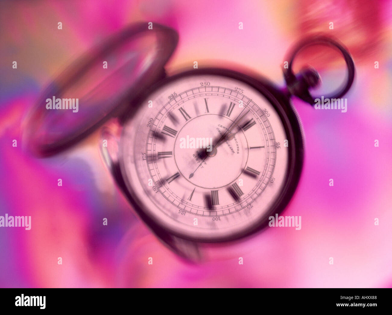 Time passing an old fashioned chronometer with Roman numerals floats through time - Stock Image