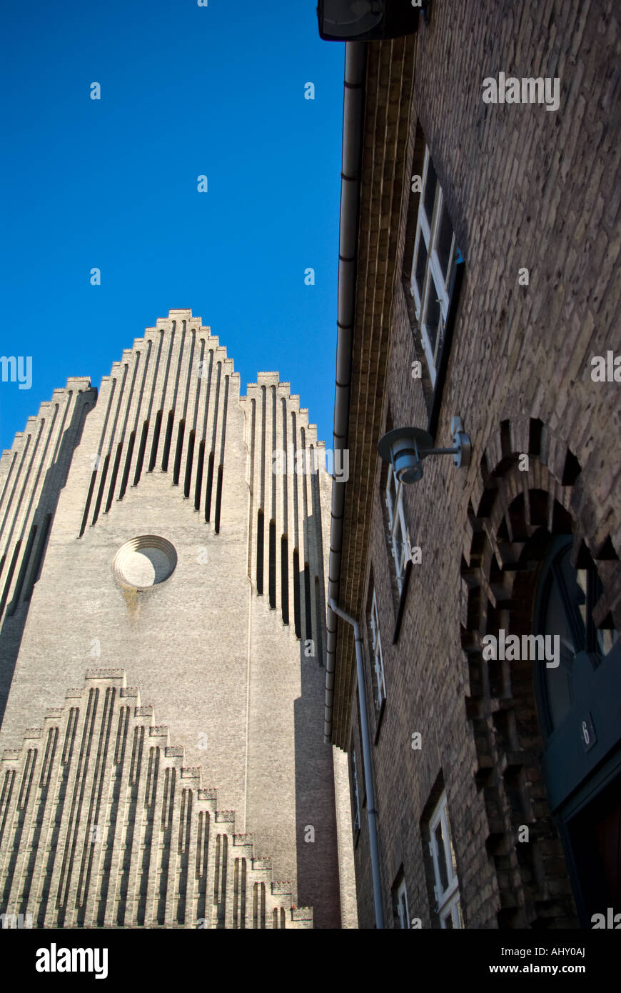 Grundtvigs Kirke (Grundtvigs Church) and a neighbouring building. - Stock Image