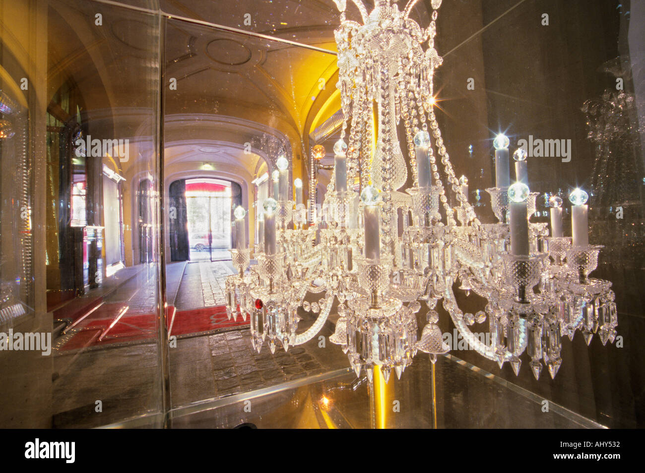 The entrance with the crystal chandelier in a giant aquarium at the the entrance with the crystal chandelier in a giant aquarium at the baccarat museum shop restaurant at the hotel de noailles aloadofball Images
