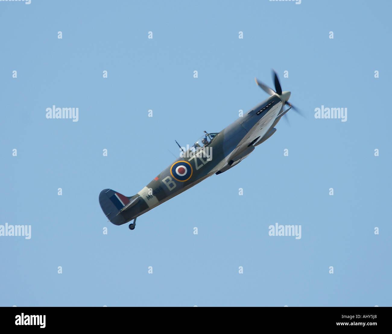 Spitfire performs aerobatics over Goodwood - Stock Image