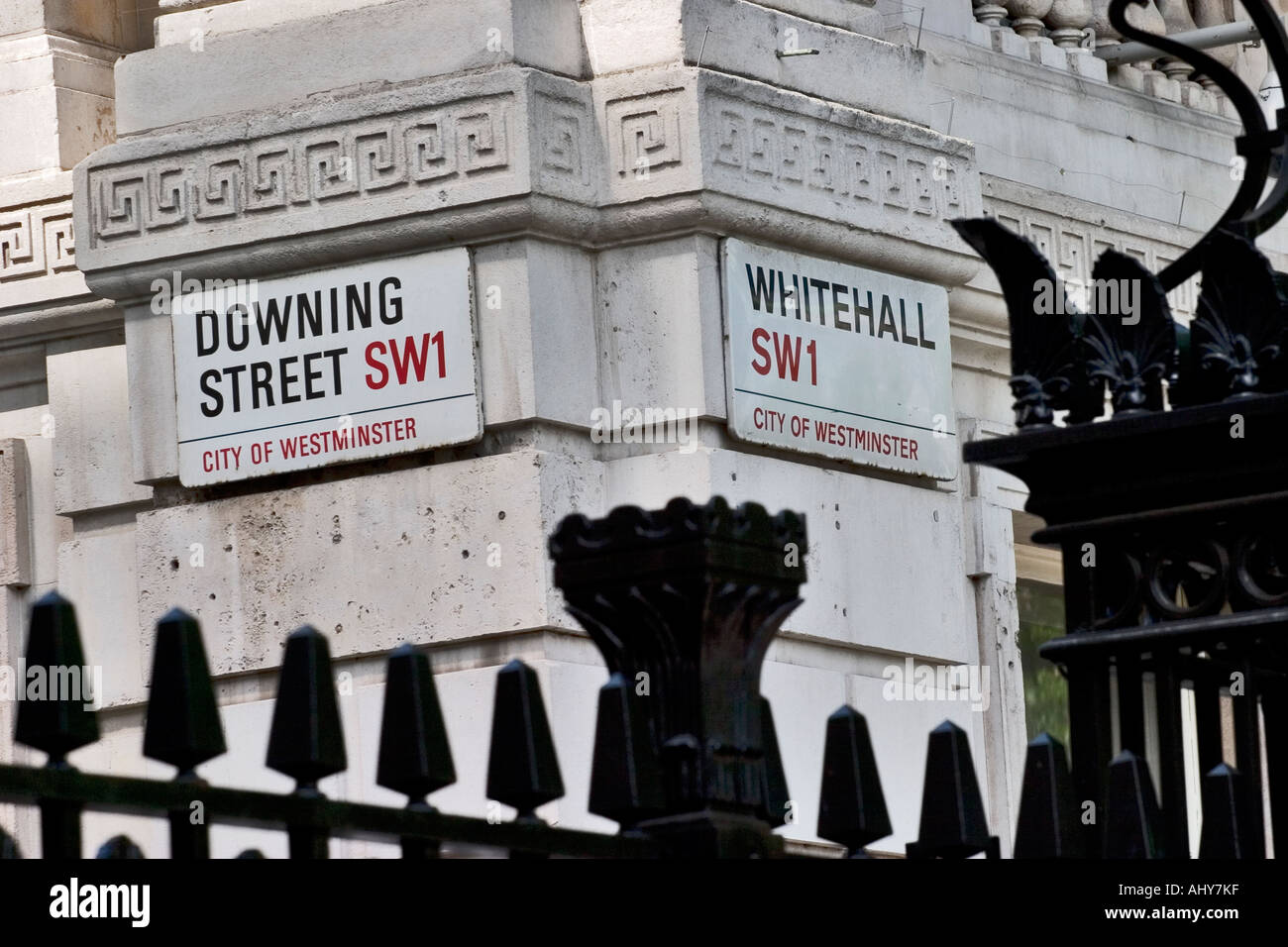 Whitehall and Downing Street signs behing the gates of Downing Street London - Stock Image