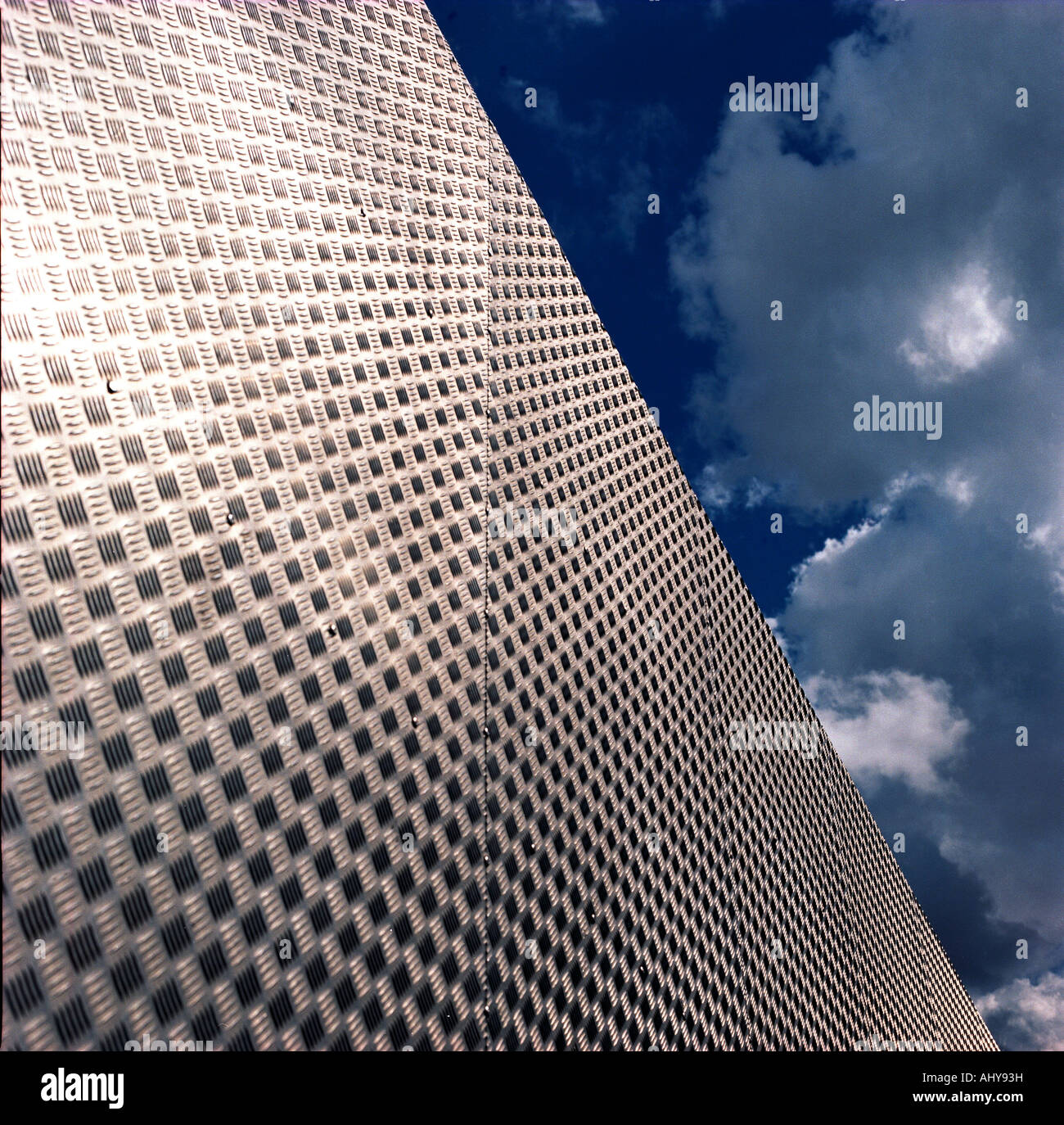 shiny metal surface against sky - Stock Image
