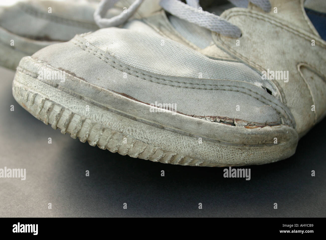 closeup of a pair of dirty old worn sneakers or running shoes Concept comfort well used durability - Stock Image
