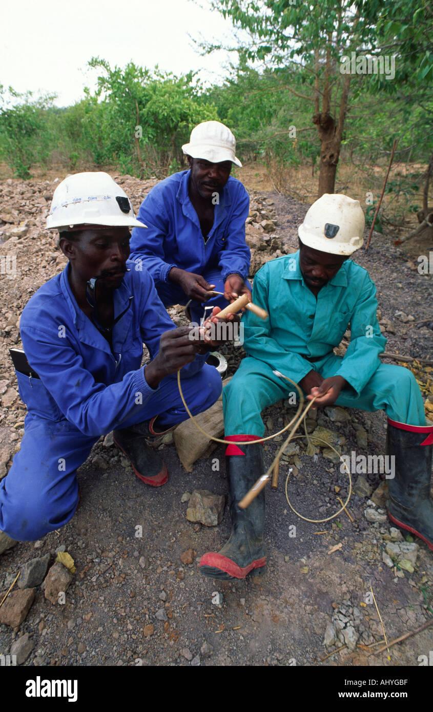 Preparing explosives for well excavation. Zimbabwe - Stock Image
