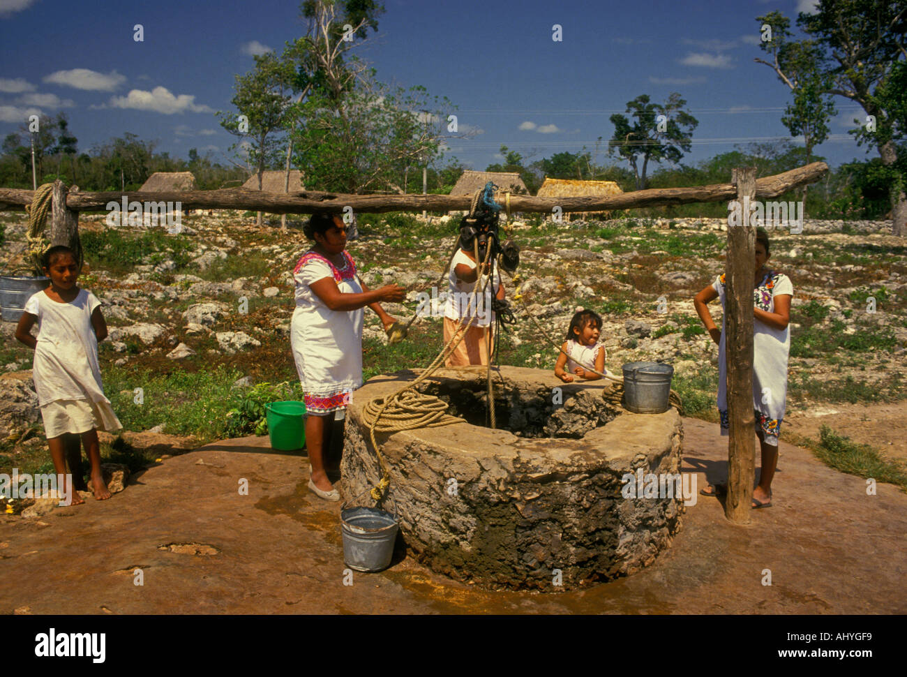 Mexican people, Mayan people, drawing water from well in the village of Palacio Gomez in Quintana Roo State in Yucatan Stock Photo