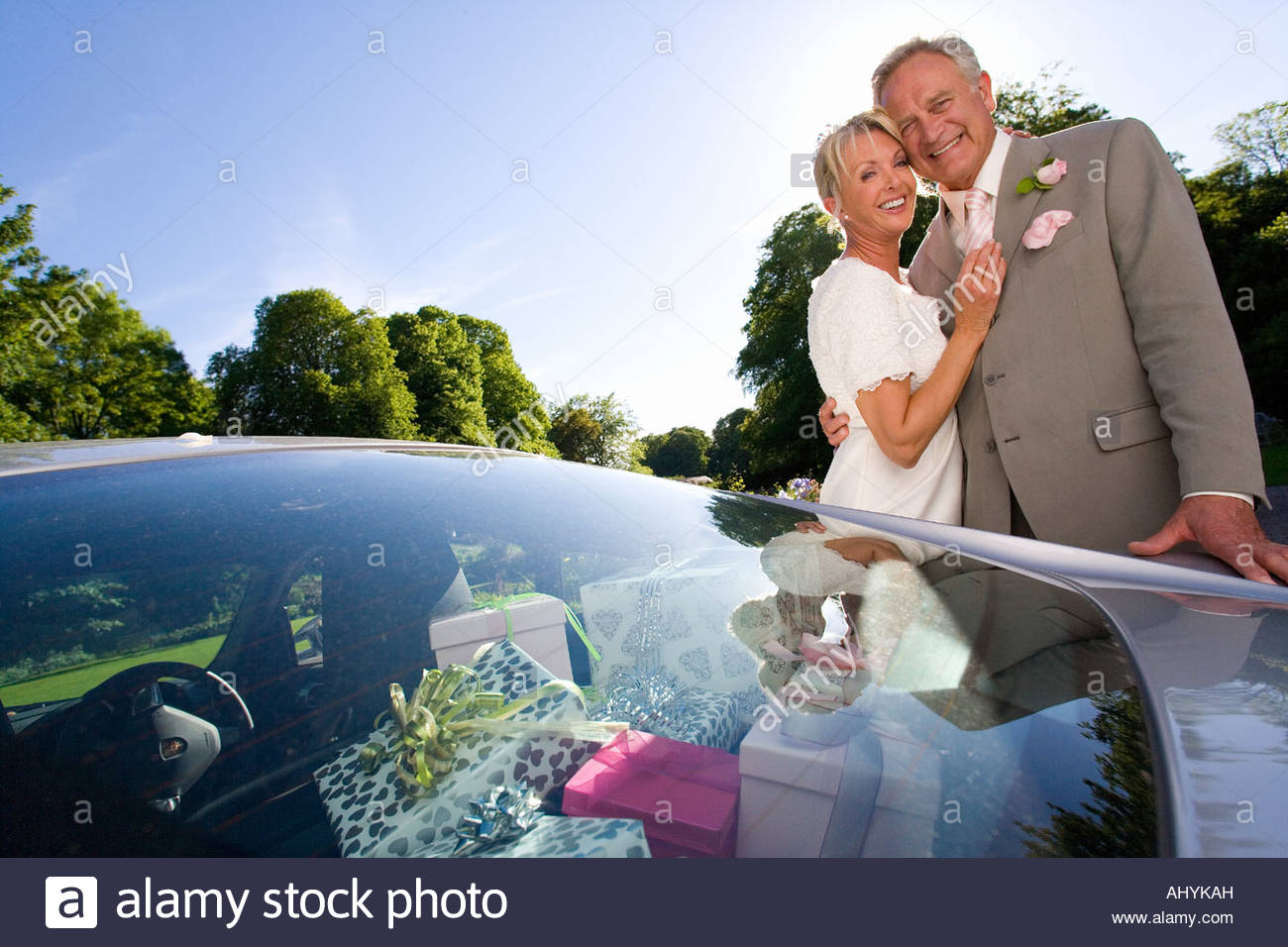 Newly Married 60 S Couple Standing Behind Car Full Of Wedding Gifts