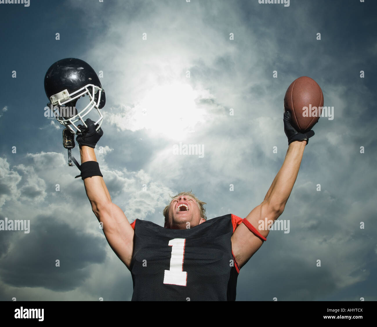 Low angle view of football player cheering - Stock Image