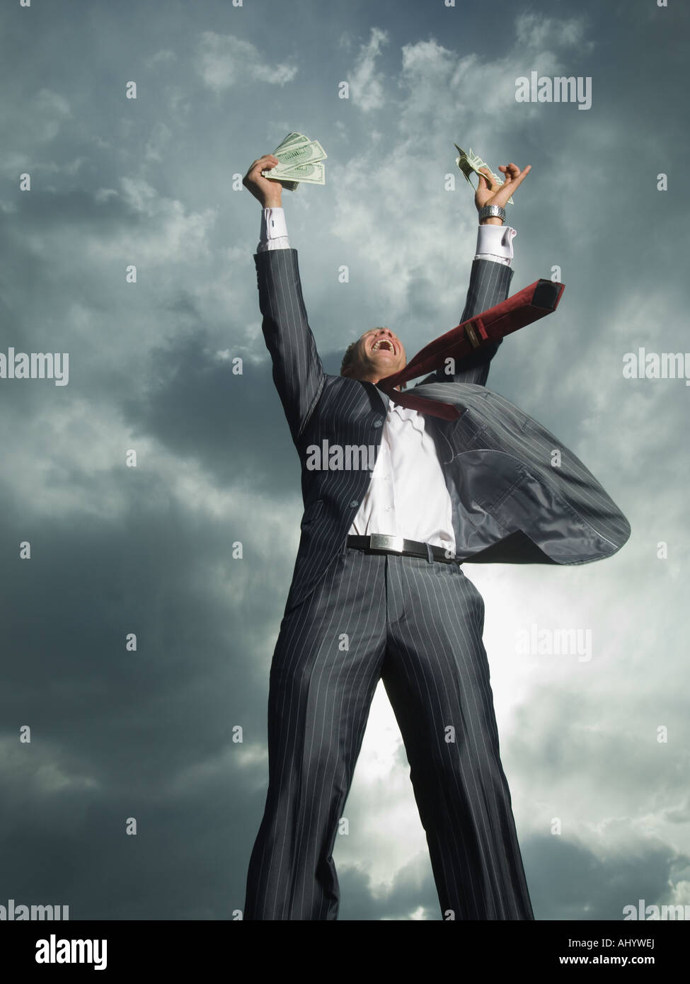Low angle view of businessman cheering - Stock Image