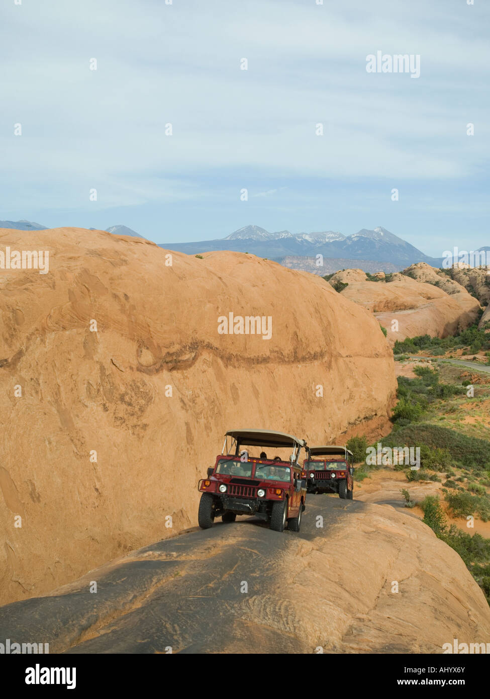 Off-road vehicles driving on rock formation - Stock Image