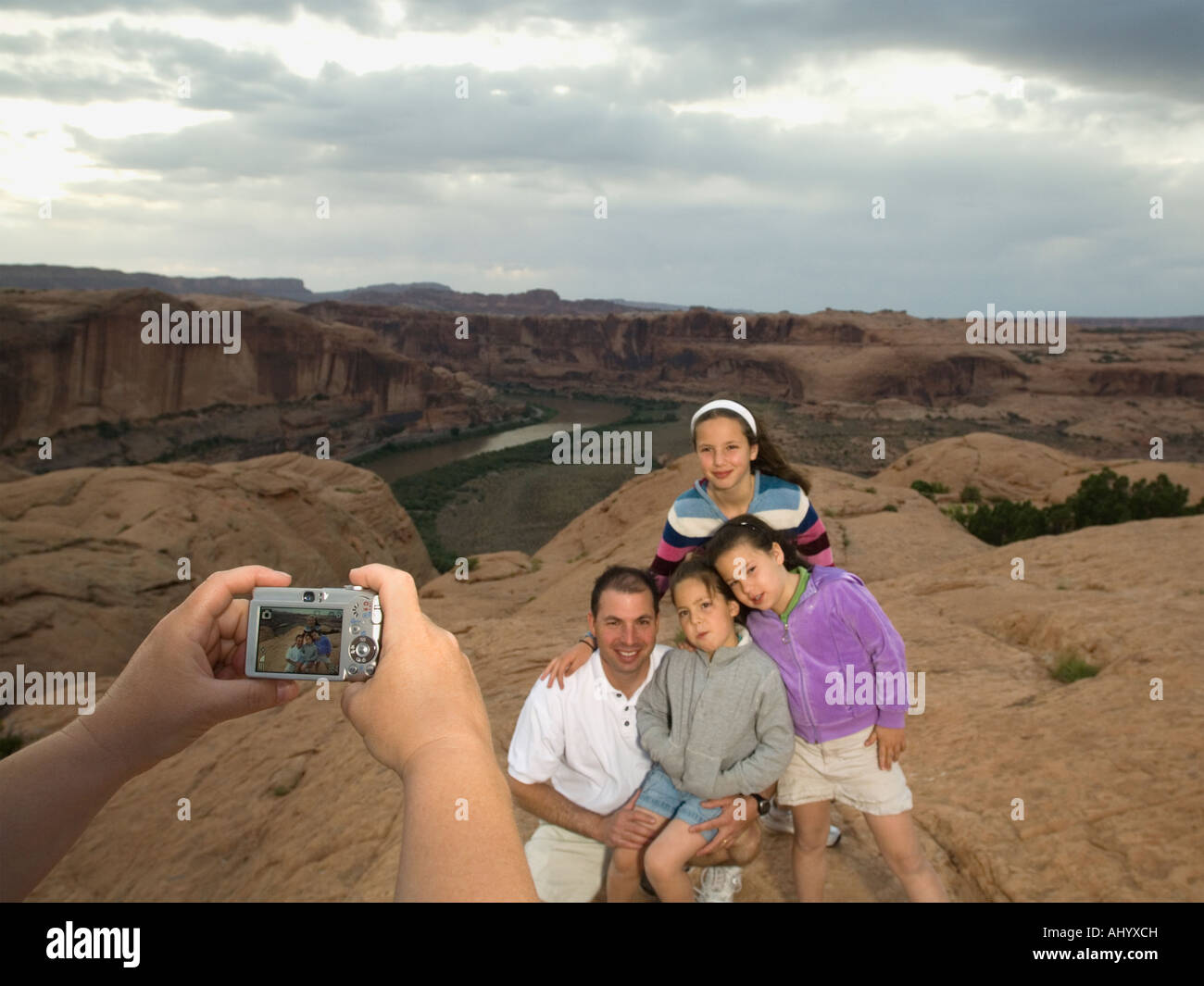 Father and daughters having photograph taken - Stock Image