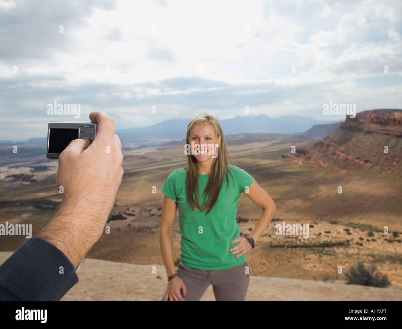 Woman having photograph taken - Stock Image