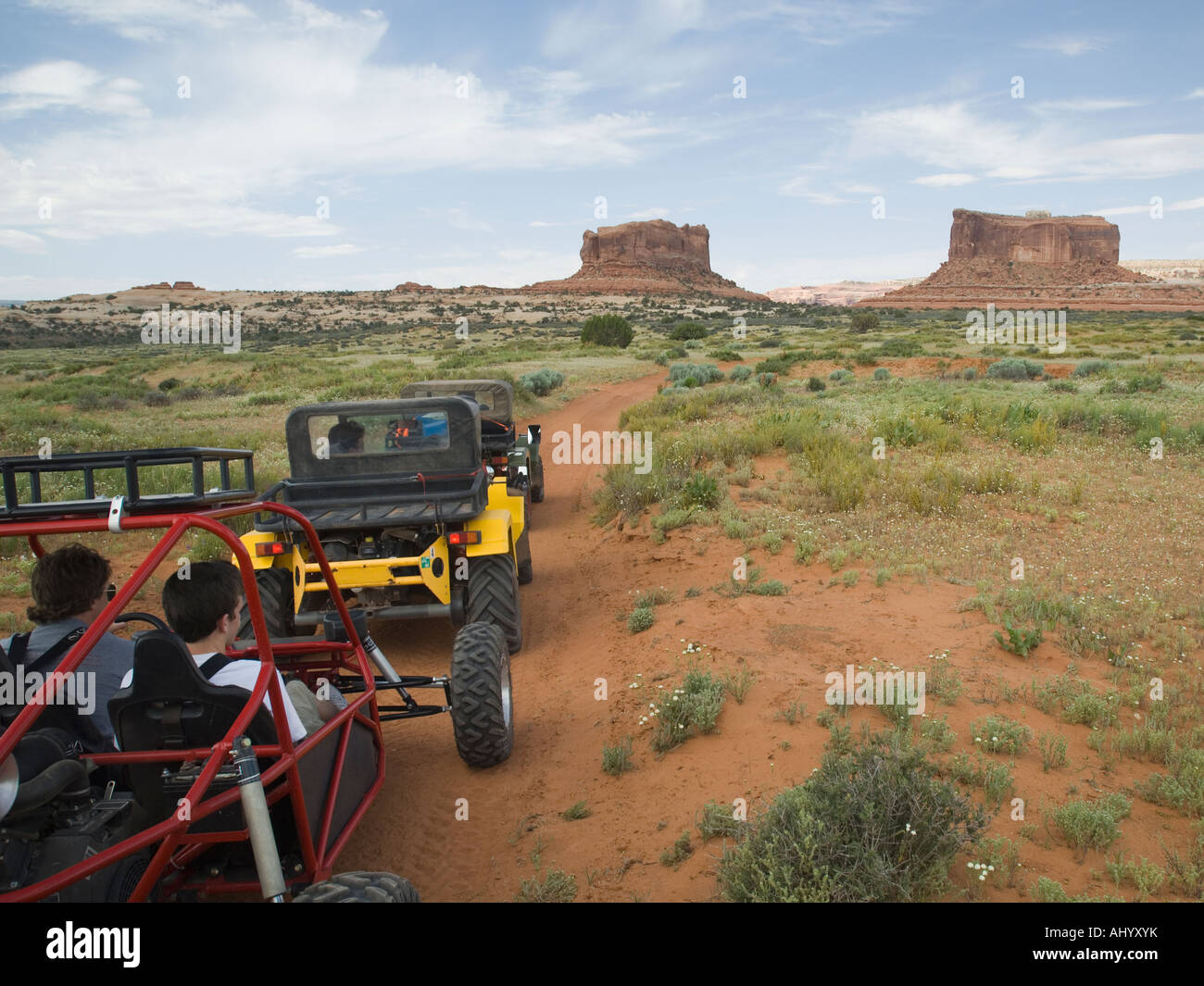 Off-road vehicles driving in desert - Stock Image