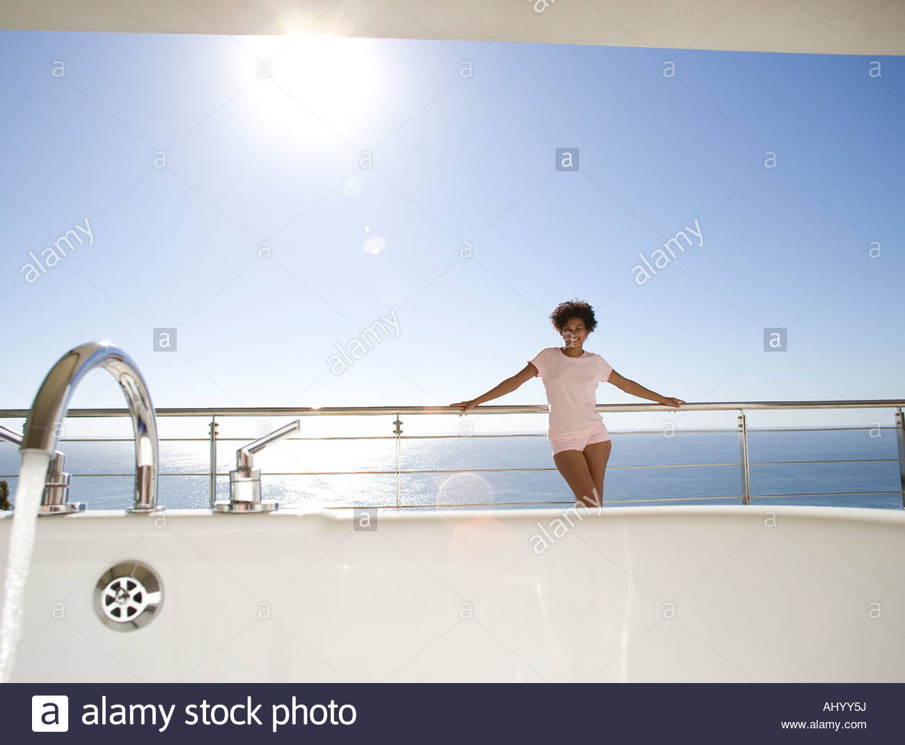 Young Women Standing On Balcony Stock Photos & Young Women Standing ...