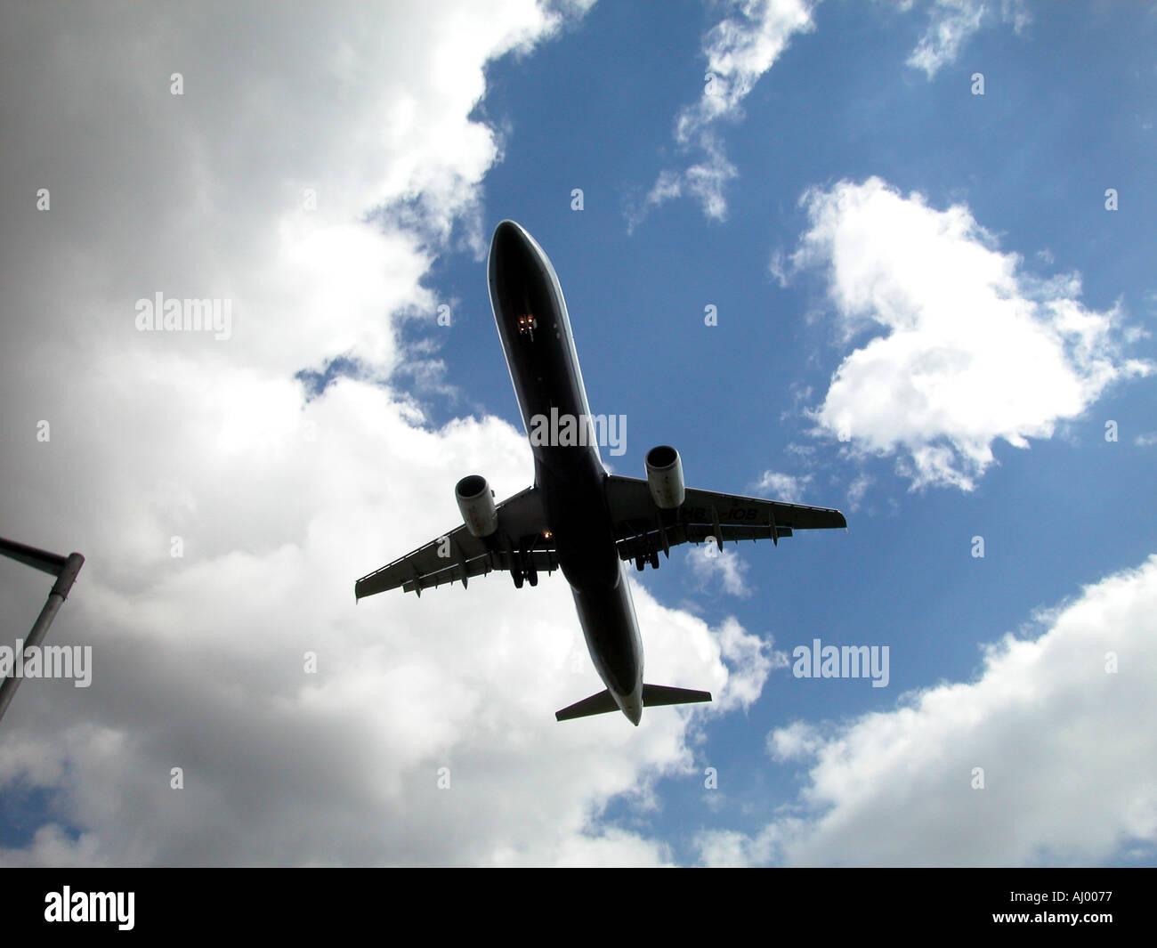 Aircraft landing at Heathrow Airport, London, England, UK. - Stock Image