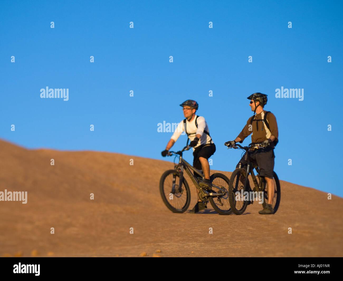 People riding mountain bikes - Stock Image