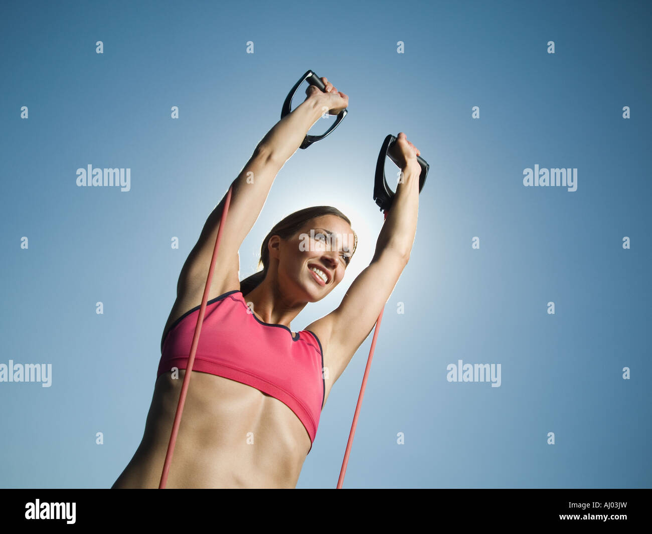 Woman in athletic gear exercising - Stock Image
