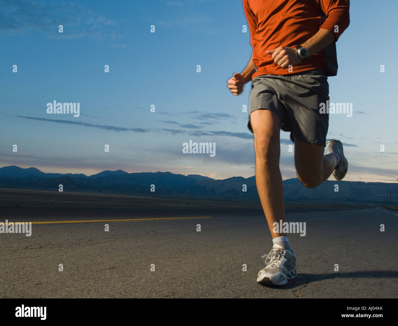 Man in athletic gear running - Stock Image