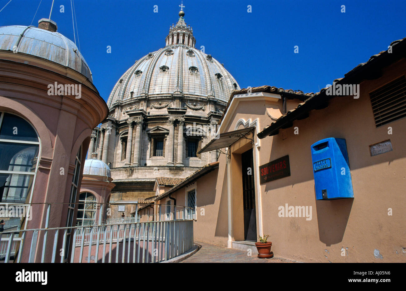 Dome of St Peter's Basilica and entrance to the souvenir shop on the roof, Vatican City - Stock Image