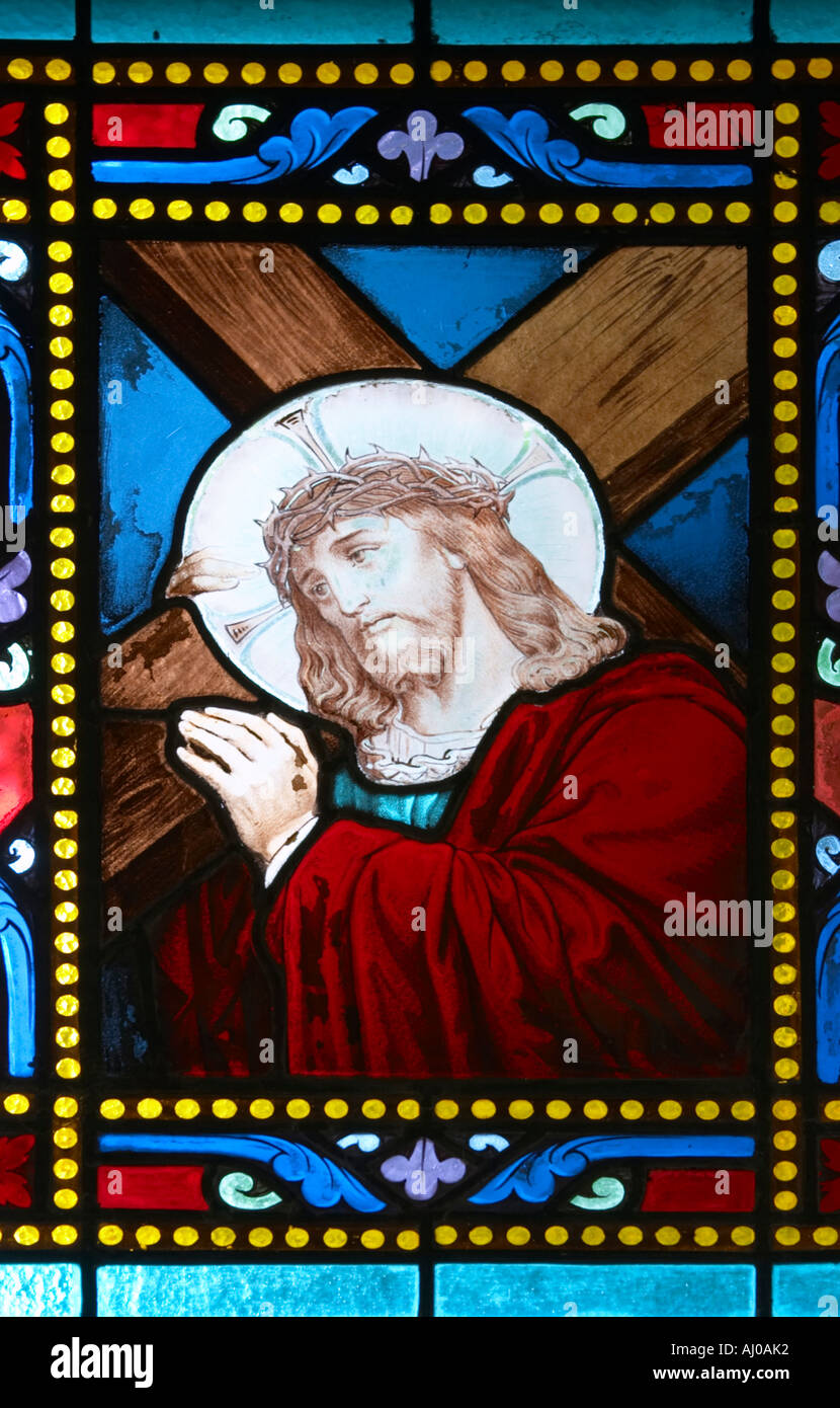 Stained glass window depicting Christ carrying the cross Montparnasse Cemetery Paris France - Stock Image