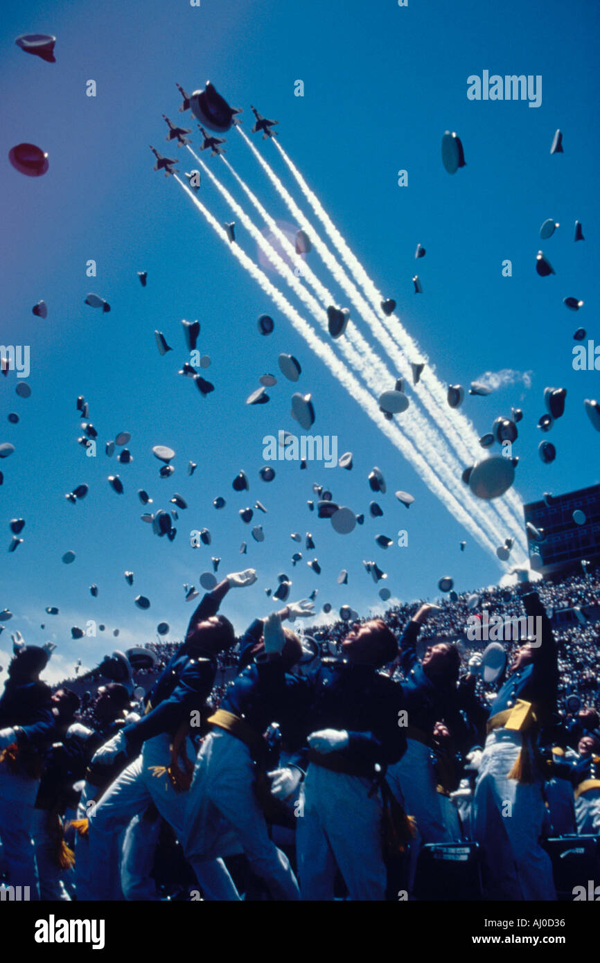U Air Force Academy graduates toss their cadet caps into the air as the USAF Thunderbirds fly overhead Colorado Stock Photo
