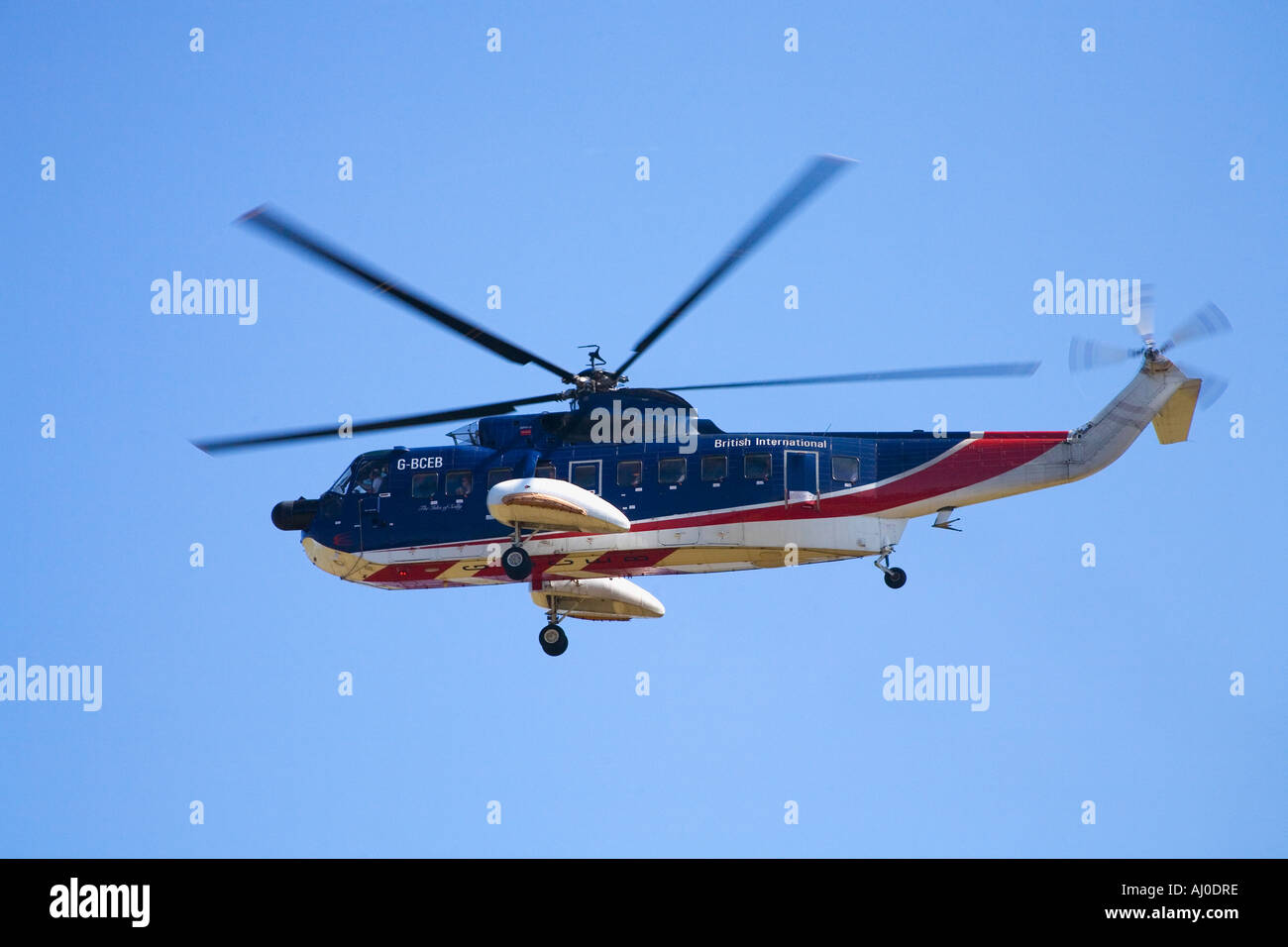 Helicopter landing at St Marys Airport on the Isles Of Scilly Cornwall England UK United Kingdom GB Great Britain British Isles - Stock Image